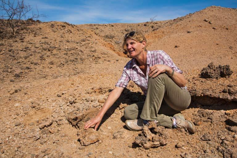 Louise Leakey examining fossils (Photo credit- Lorna Buchanan-Jardine)