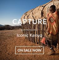 Local child outside a traditional African mud hut in Samburu village by Sasaab Lodge Kenya