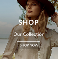 Stunning woman in white shirt safari outfit and brown hat