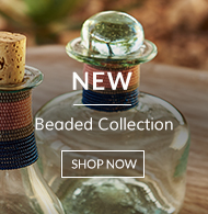 Beautiful beaded bottle linking to shop